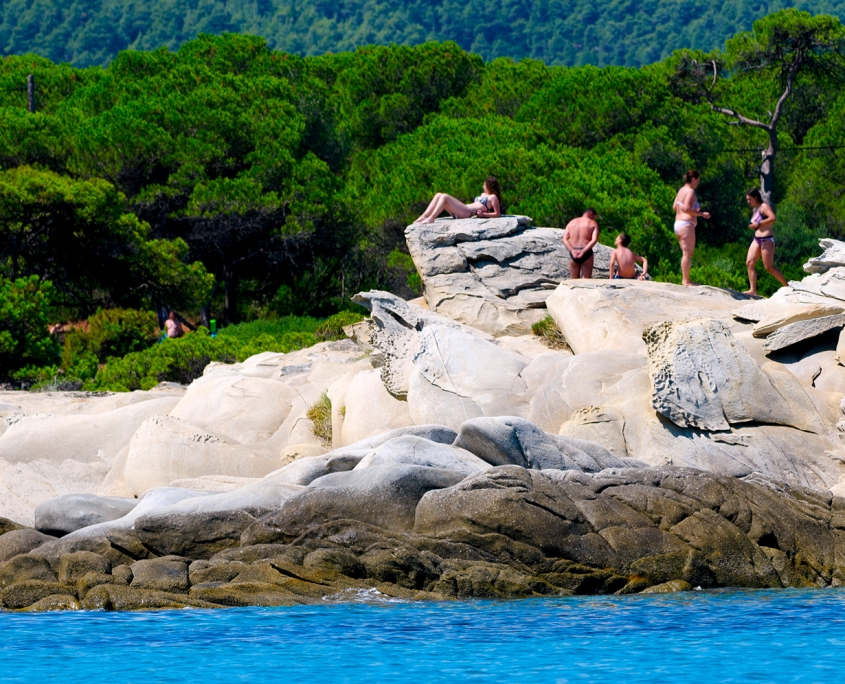rent a boat in Chalkidiki to visit Myrsini Beach
